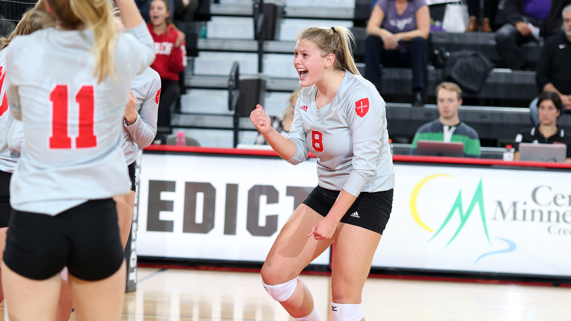 Katie Koch celebrates after scoring a point against St. Thomas